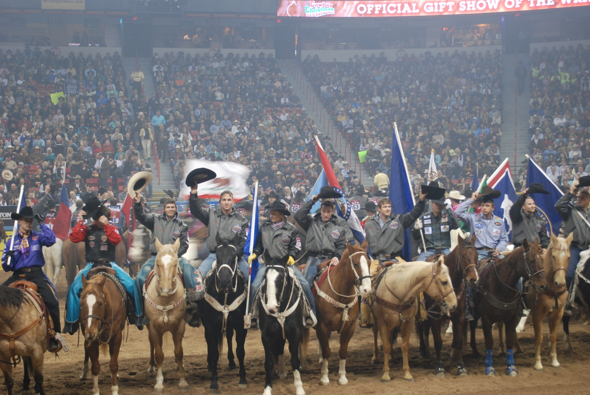 Contestants tip their hats to the fans during the grand entry