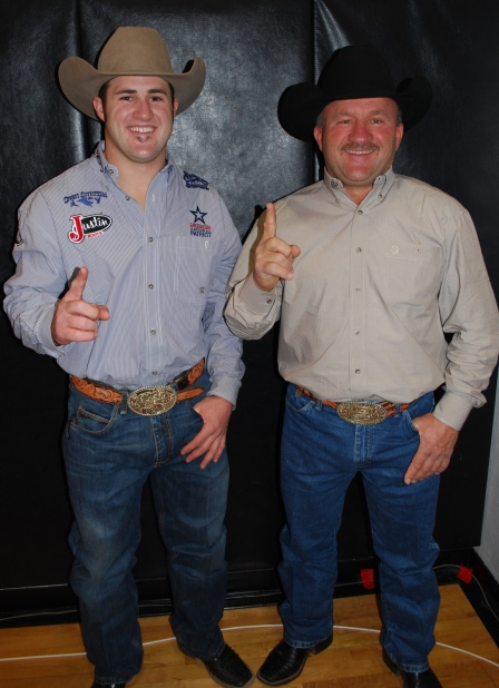 Lewis Feild, right, was one proud papa after Kaycee won his first gold buckle in 2011.