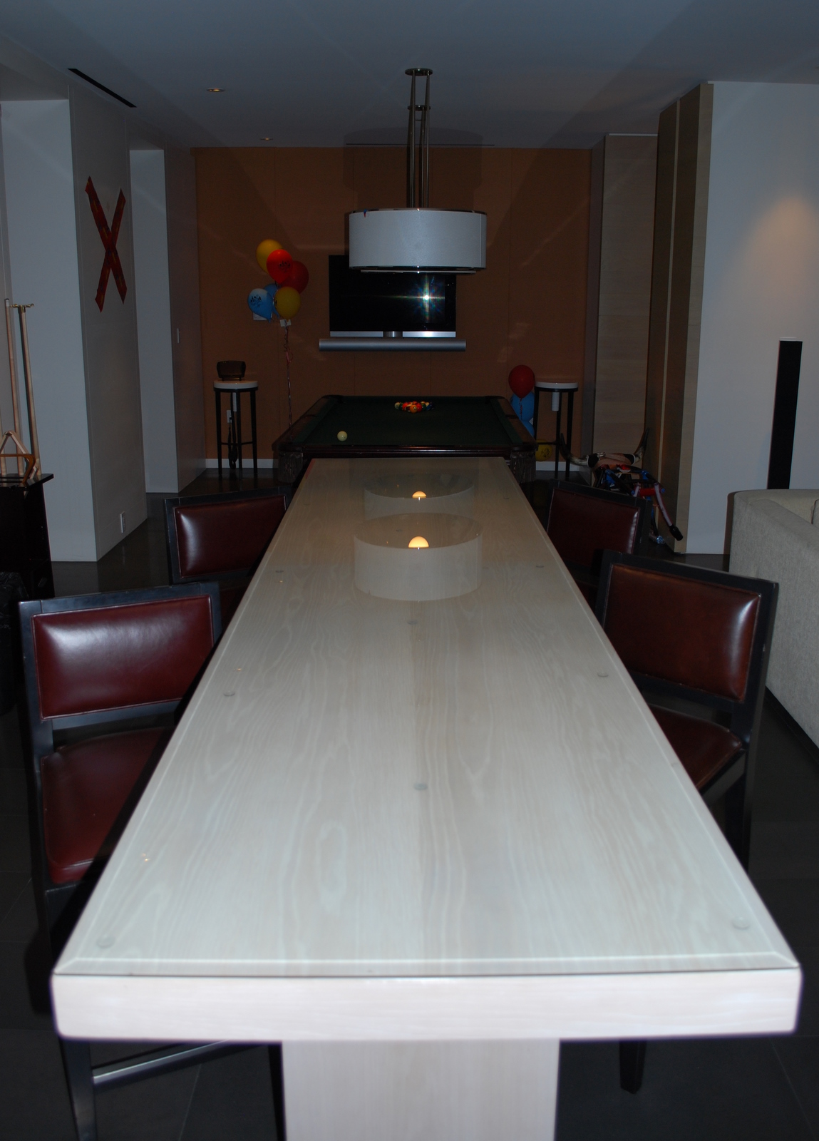 Trevoru0027s Suite Includes A Long Marble Dining Table And Pool Table.