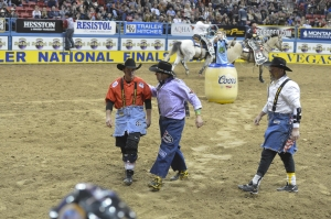 Australian bullfighter Darrell Diefenbach, left, has enjoyed workign this Wrangler NFR with Dusty Tuckness, center, and Kelly Jennings.  (PRCA ProRodeo photo by Greg Westfall)