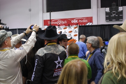 Kaycee Feild and the rest of the 2012 World Champions were mobbed by reporters after claiming their gold buckles Saturday night.