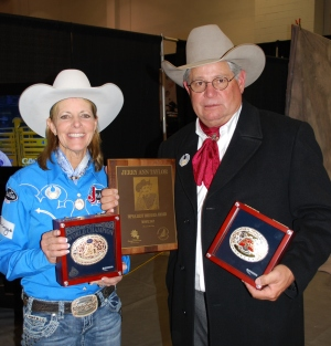 Mary Walker held her World Champion buckle while her husband, 1981 World Champion Steer Wrestler Byron Walker, showed off her RAM Top Gun Award and Jerry Ann Taylor Best Dressed Award.