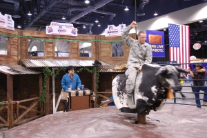 Some soldiers from Nellis Air Force base in Las Vegas tried their hands at riding the mechanical bull at Fanfest on Thursday.