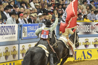 Wrangler NFR rookie saddle bronc rider Tyrell Smith enjoyed a victory lap after winning Round 8.  (PRCA ProRodeo photo by Greg Westfall)