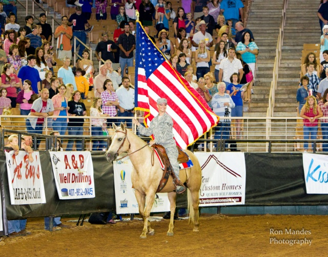 One of the highlights of Jenna Smeenk's year has been carrying the American flag in uniform at rodeos.  --Ron Mandes photo