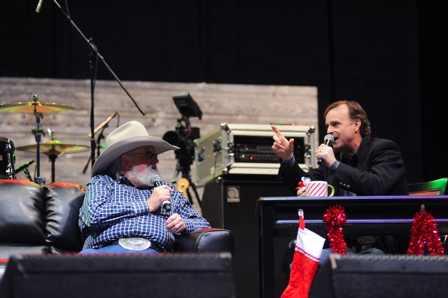 "Beloved funny man Flint Rasmussen, shown here interviewing country music legend Charlie Daniels, will be back at Cowboy FanFest and Cowboy Christmas to host his highly popular show ""Outside the Barrel"" each day."