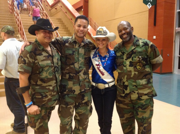 Jenna Smeenk, shown here with some wounded veterans, enjoys spending time promoting the sport of rodeo and the military during her travels.