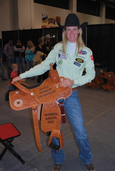 Sherry Cervi posed for a photo while holding her 2013 world champion saddle, the fourth of her illustrious career.