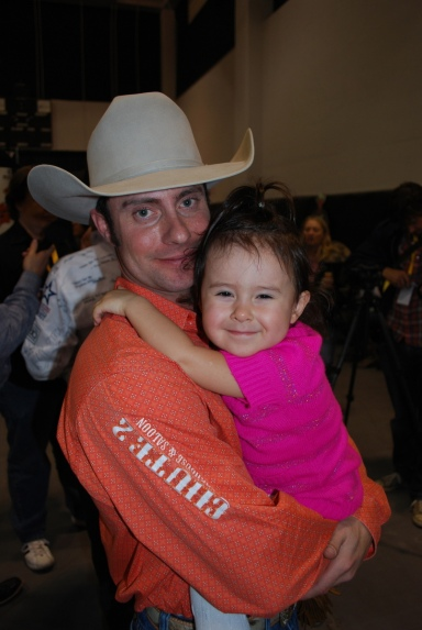 Chad Ferley got some quality time with his daughter, Teagan, after winning his second gold buckle.
