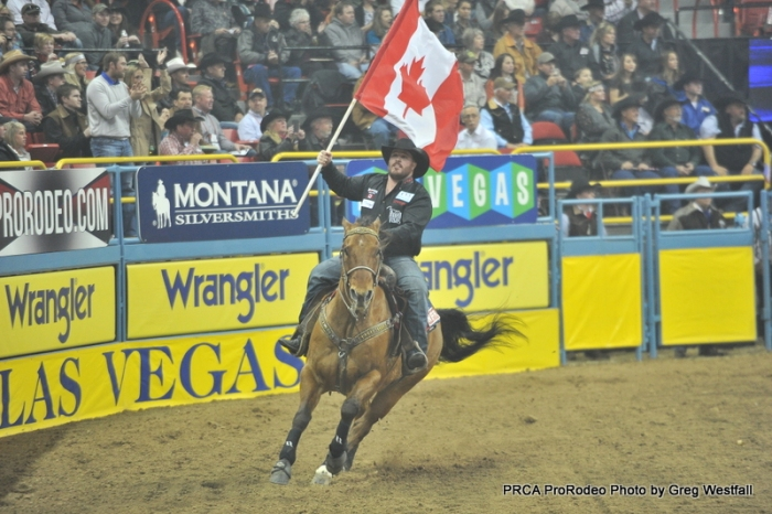 Carrying the Canadian flag into the Thomas & Mack Center each night has been a big honor for steer wrestler Straws Milan.