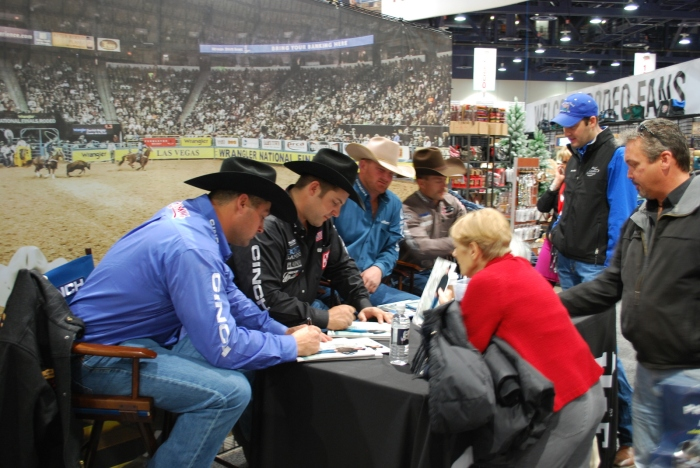 Wrangler NFR steer wrestlers (from l to r) Jason Miller, Luke Branquinho and Wade Sumpter joined former Wrangler NFR saddle bronc rider Cody DeMoss in signing autographs at Cowboy Christmas on Thursday morning.