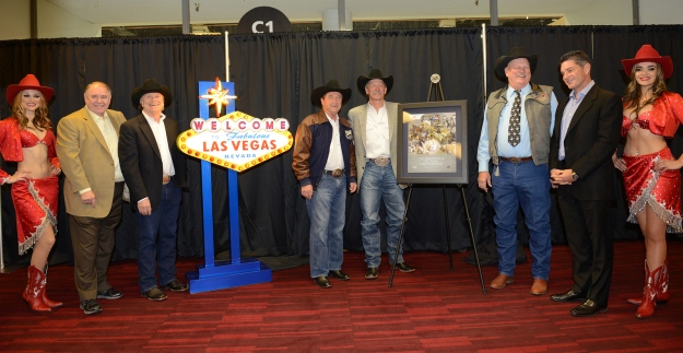 Representatives from Las Vegas Events, the Las Vegas Convention and Visitors Authority and the Professional Rodeo Cowboys Association are joined by Las Vegas showgirls to commemorate the agreement to keep the Wrangler National Finals Rodeo in Las Vegas through 2024. The group includes (from left to right) Michael Gaughan, LVE Board Member; Pat Christenson, LVE President; Rossi Ralenkotter, president/CEO of the LVCVA; Karl Stressman, PRCA Commissioner; Tom Collins, LVCVA Chairman and LVE Board Member; and Bill McBeath, LVE Board Member.
