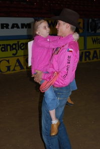 Tuf Cooper has a dedicated fan base and always makes time for his fans. Here, he enjoyed helping a special friend at the Wrangler NFR Exceptional Rodeo in 2011.