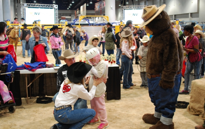 Smokey the Bear helped Ruth Dismuke-Blakely hand out trophies at the 32nd annual Wrangler NFR Exceptional Rodeo.