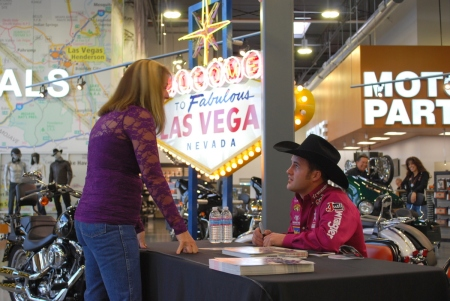 Kaycee Feild signed autographs for an hour at the local Harley-Davidson dealership and had fun interacting with rodeo fans who stopped by.