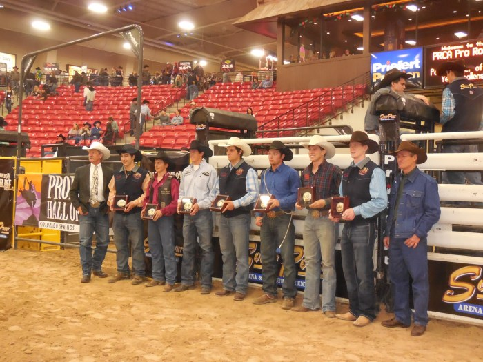PRCA Commissioner Karl Stressman, left, and ProRodeo Hall of Famer Clint Johnson, right, congratulated this year's PRCA Permit Challenge winners at the South Point arena.  --Photo courtesy of Susan Kanode