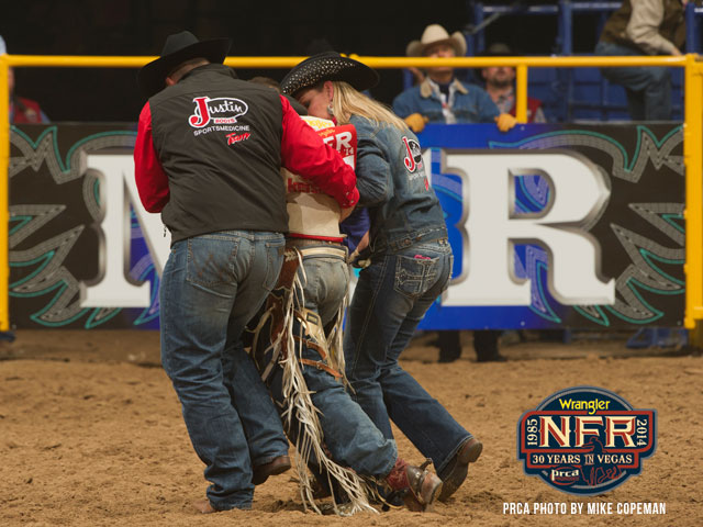 Members of the Justin Sports Medicine Team had to help Steven Peebles from the arena on Saturday night after he suffered a gnarly back injury.  --PRCA photo by Mike Copeman
