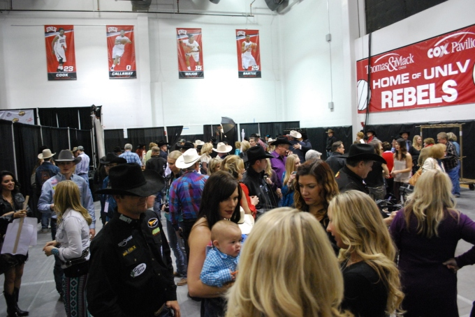 World Champions Kaycee Feild and Luke Branquinho were among the sea of people who gathered in the Wrangler NFR press room after Round 10.