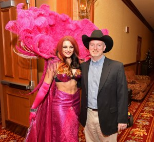 "One of the showgirls must be a fan of ""NFR Insider,"" because she asked for a photo. Naturally, I obliged.  --PRCA photo by Greg Westfall"