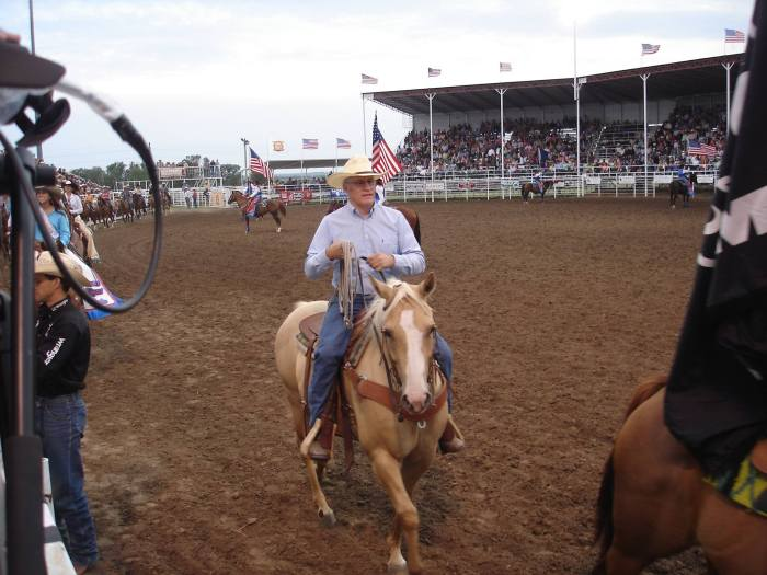 Dr. Boyington participates in the grand entry at Kansas' Biggest Rodeo in Phillipsburg. He has been part of the committee for over 25 years (PRCA)