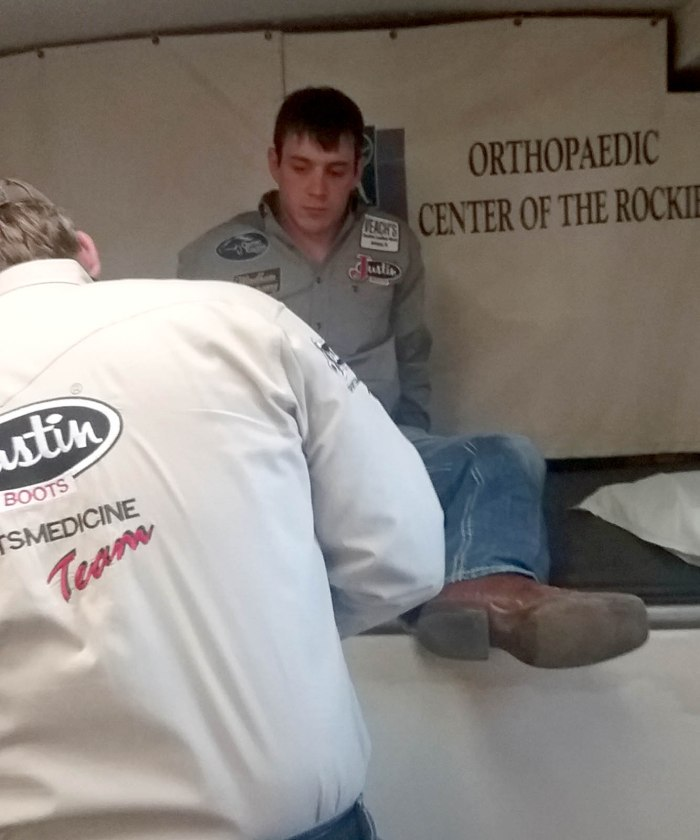 Tim took a little extra time in the Justin Sportsmedicine trailer at the Cody Stampede after spraining his ankle in Prescott, Arizona.